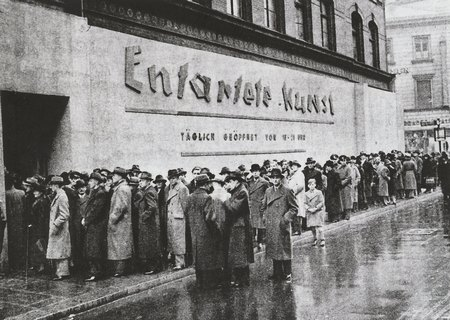 Viewers about to enter the original Entartete Kunst exhibition,  Munich, April – November 1937.