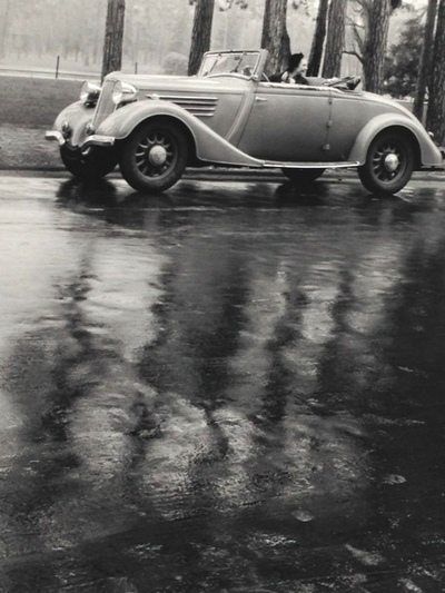 Getting Wet in Cabriolet Paris 1935 by Doisneau