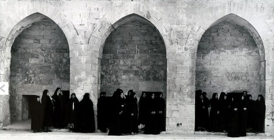 Soliloquy, 1999, Two-channel video installation. Color. Sound. Running time: 17 minutes, 30 seconds, director: Shirin Neshat, in collaboration with Shoja Azari. Cast: Shirin Neshat. Writers: Shirin Neshat and Shoja Azari. Director of photography: Ghasem Ebrahimian. Composer and sound designer: Sussan Deyhim. Producer: Barbara Gladstone. Filmed in Turkey. Shot on 16mm color film.