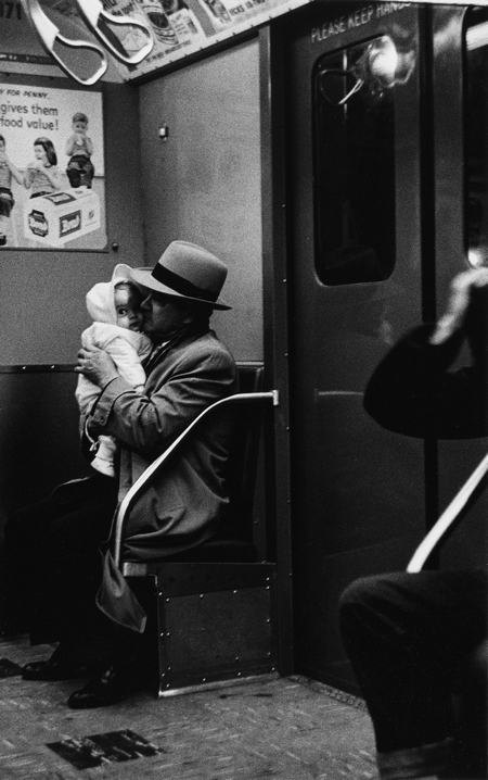 Man with a curious baby on the subway, N.Y.C. 1956