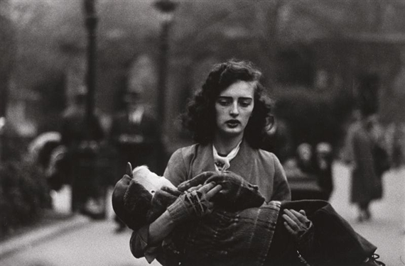 Woman carrying a child in central park